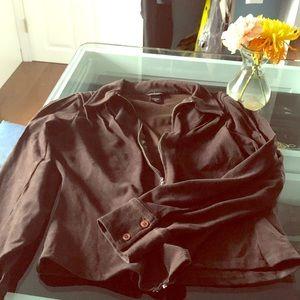 Brown zip front shirt.